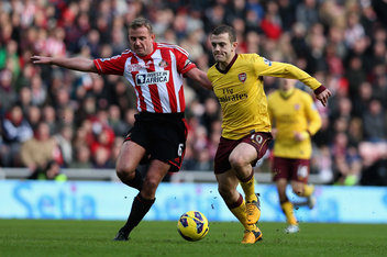 Wilshere out does the brute that is Cattermole